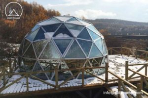 Weather-Resistant Glass Geodesic Tent for Snowfield Campsite
